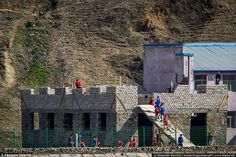 Teaching: These schoolchildren were observed helping to build a block during a physical ed...