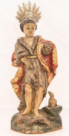 Imagem de madeira policromada, São João Batista. Bahia, século XIX. Alt. 29cm. Vendido 850,00.