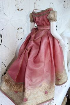 Beautiful-dress-for-antique-French-fashion-doll-18inch-1860years (I believe she used a silk Sari for this dress. It sold for $511.34! on eBay.)