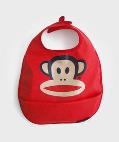 Cool, red bib with the monkey Julius printed on it. PU-coated polyester - durable, practical and completely PVC-free material Easily rinsed or wiped c