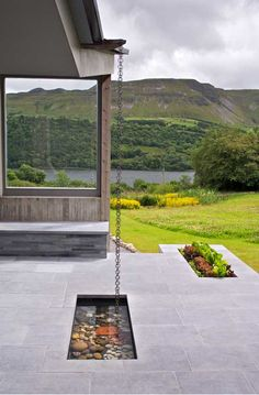 Inverted roof with pull chain to harvest rainwater. LID Architecture Ireland.