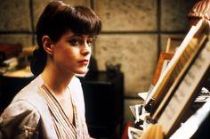 Sean Young as Rachel  (Blade Runner)   Just about as cool as you can get...
