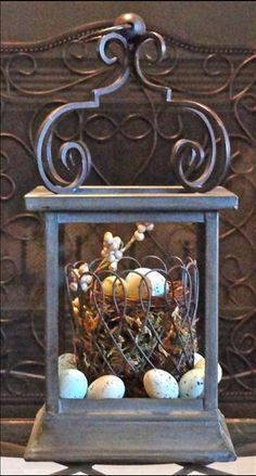 Easter nest from www.imagine.willowhouse.com. Drake Lantern with outside part of small French Wire Planter