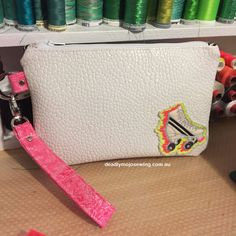 **Custom for Paige**Shimmery, shiny vinyl zippered clutch with hand crafted flaming neon roller skate motif on the front. Features a mesh internal slip pocket and coordinating retro roller skat...