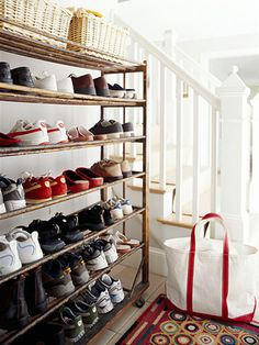 Shelf Your Shoes- At the back door, an antique shoe rack maintains order by ensuring ready access to footwear. An absorbent patterned rug hides messy footprints and warms stockinged feet. Place a chair or bench next to the rack to make removing or putting on shoes a bit easier and more comfortable.
