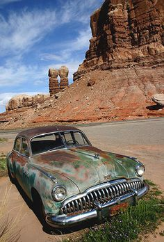 Old Buick in Bluff Utah at the Cow Canyon Trading Post Twin Rocks in the background