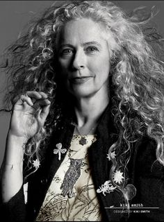 the so so beautiful kiki smith. i own one of her star broches, similar to the ones pinned on her jacket. it is one of my prized possessions.