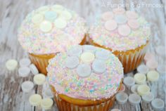 Can we discuss how yummy these Smarties cupcakes look?  Beautiful pastel sprinkles with Smarties tablets making a flower.  YUM!