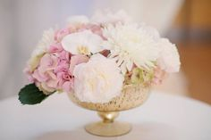 A small and elegant centerpiece can make a large impact on your guests.  Created by Akiko Floral Artistry.  Photo Credit:  Milton Photography.  #phalaenopsis #orchids #blush #gold #blushandgold #ivory #tulips #roses #peonies #hydrangea #chrysanthemum