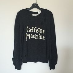 Wildfox Caffeine Machine sweater Need coffee now! Heavy knit sweater with an oversized, effortless fit. Wear and tear for that well-traveled look of your favorite vintage sweater. In Vintage Lace Dirty Black. 70% Acrylic, 15% Nylon, 8% Wool, 7% Alpaca. Brand new with tags, never washed/worn. Super cute for any Wildfox lovers AND coffee addicts :) Model in the second photo IS wearing size S, the size I am selling. Retails $167 (after CA tax). **Join Poshmark app with my code HPYGO and get $10…