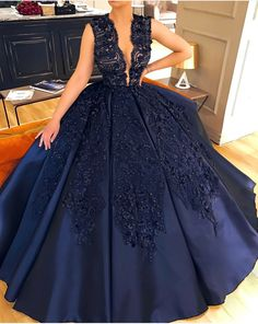 Midnight blue deep plunging beaded ball gown