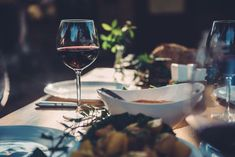 Glass of red wine at dining table in backyard patio Salad Buffet, Legacy Collection, Red Glass, Outdoor Seating, Backyard Patio, Red Wine, Photo Editing, Dining Table, Restaurant