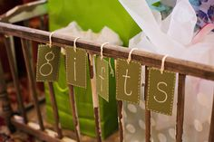 Put gifts at a baby shower in an old crib.