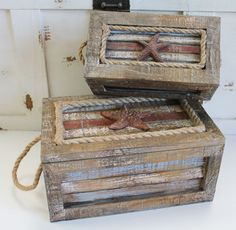 """Natural wood, rustic blue and red resting boxes can be used as decorative nautical decor or as a practical trinket box. Larger box measures 10""""w and small inner box is 7""""w."""