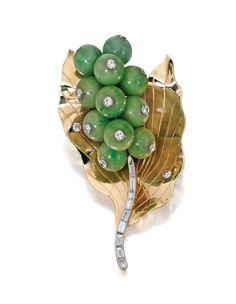 An 18 karat gold, jade and diamond brooch, Cartier, circa 1950.