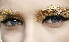 Gold eyebrows are all the rage in the Capitol this year. Purple eyebrows out, gold eyebrows in. Perfect for the girl who doesn't have enough makeup already flaking into her eyeballs. Gold Makeup, Glitter Makeup, Makeup Art, Hair Makeup, Glitter Nails, Makeup Eyes, Sparkle Makeup, 80s Makeup, Witch Makeup