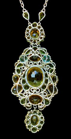 Dorrie Nossiter. Arts and Crafts pendant. Silver, gold, citrine, zircon and peridot, c. 1930. Pendant: H: 11.1 cm (4.37 in); W: 4.4 cm (1.73 in). Chain: L: 72 cm (28.35 in). Fitted case. Sold by Tadema Gallery. View 4.