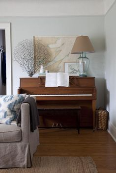 decorating around an upright piano - love the lamp and a little basket on the side would be great to store the piano books! finally found a great spot to put them.