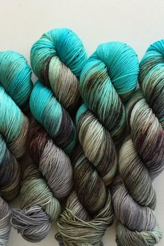Abyss | 75/25 superwash merino/nylon sock fingering weight | variegated cyan turquoise aqua blue dark espresso brown grey gray charcoal ocean inspired