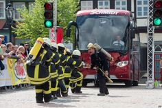 A team of the fire brigades competes in the 11th edition of the German Bus-pulling Championshipin Wolfenbuettel, western Germany.