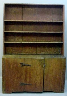 EARLY CANT BACK OPEN PEWTER CUPBOARD. New England.
