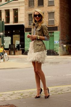 Stripes and military style vest mixed with fluffy super feminine skirt. It works!