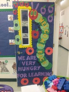 This is a cute classroom door display based on Eric Carle's book The Very Hungry. - This is a cute classroom door display based on Eric Carle's book The Very Hungry Caterpillar. Classroom Door Displays, Classroom Themes, Library Displays, Classroom Libraries, Art Classroom, School Classroom, Hungry Caterpillar Classroom, Caterpillar Bulletin Board, Caterpillar Art
