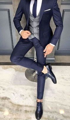 This men's blue suit paired with silver/grey vest would be the perfect groom or groomsmen outfits for your wedding! We can custom make it for you in our Giorgenti New York showroom. suits men Giorgenti New York Trendy Mens Fashion, Mens Fashion Suits, Fashion Menswear, Wedding Dress Suit, Dress Suits, Wedding Suits For Groom, Shirt Dress, Blue Suit Men, Men In Suits