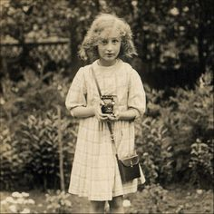 Little girl with a camera, ca. 1940s