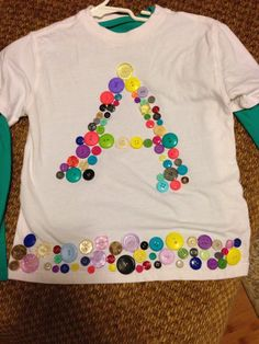 Amelia's button T-shirt for the 100th day of school