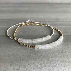 This delicate Rainbow Moonstone bracelet features small natural stones. The semi precious stones are an iridescent white hue with beautiful flashes of blue. Its a versatile, minimalist piece thats sure to become one of your favorites. Choose either gold or silver beads with your