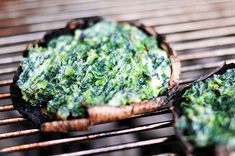 Portobello mushrooms stuffed with spinach and goat cheese, cooked on a grill.