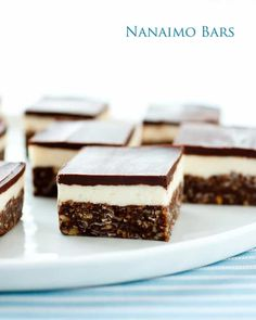 Nanaimo Bars - Cooking Classy --- I substituted the graham crumbs with All Bran Buds and the butter and cream in the second layer with coconut oil, yogurt, and a bit of water: so delicious! No Bake Treats, No Bake Desserts, Just Desserts, Yummy Treats, Delicious Desserts, Sweet Treats, Dessert Recipes, Holiday Desserts, Cookie Recipes