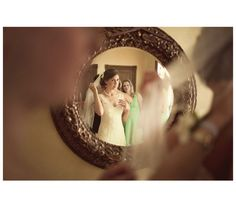 Photos-Bride looking at herself in the mirror