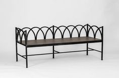 Perfect for an entryway or front porch, the Dorris transitional bench has interlocking half-moon curves finished in antique black that give way to a natural distressed oak seat. | Dorris Bench | Gabby