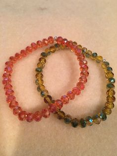 Faceted Autumn Tangerine Orange & Yellow-Green Aurora Borealis Crystal Bead Stretch Bracelet Set with Sterling Silver Accent https://www.etsy.com/listing/480270889/faceted-autumn-orange-yellow-green