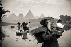 I've been photographing this area in Guangxi province, China, since 2006 and witnessing the fast decay of the cormorant fisherman. The man in the foreground is over 90 and is one  of the last in activity. The youngest fisherman are attracted by new and more profitable jobs, opening the way for the disappearing of a traditional craft and culture.