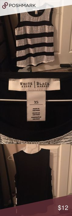 White House Black Market Shell Black and white stripe tank top that can go under any blazer or jacket but also be worn with denim for an easy outfit. Never Worn White House Black Market Tops Blouses