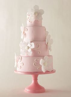 Jennifer Jones's blush-pink cake, which echoes the wedding invitation of one of her clients, walks just the right line between girly and elegant. Fondant cake with paper-wafer flowers,