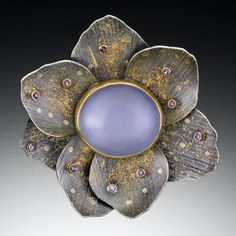 Karin Worden, Anemone Pin/Pendant, 2010, sterling, 24k, 22k, 18k gold with chalcedony and purple sapphires, photo: Hap Sakwa