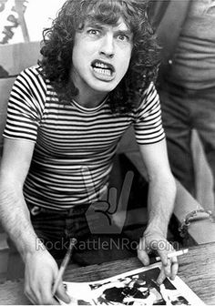 Angus Young signing autographs