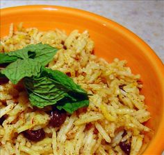 Middle Eastern Raisin Rice from Food.com:   A twist on a Middle East recipe with a splash of Afghan and Central Asia.