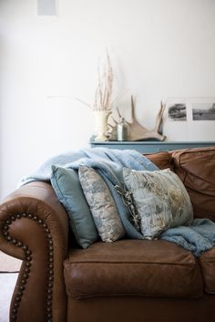 Great Antler idea-Kalispell Montana Home // A Shop-Owner's Gorgeous Renovated Home via Vintage… Brown Leather Couch Living Room, Brown And Blue Living Room, Brown Sofa, Living Room Grey, Living Room Sofa, Home Living Room, Living Room Decor, Dining Rooms, Living Colors