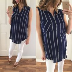 "Last Item • Navy Blue & White Striped Blouse • Item Information: a great go to for work or for a summery day! Pair it with white skinnies or slacks. 1 front chest pocket, button-up closure and high side slits. 93% poly 7% spandex. Small: 29"" long in front 32"" in back 19"" across chest.   • Size I'm modeling: Small   • Sizes available: Small   {{ Please do not purchase this listing, I will create you a new listing to purchase }} Thank you! Xo Tops Blouses"