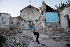What a beautiful art place this would have been, and still is. 20 Photos: A man sweeps in the earthquake-damaged Santa Ana church in Port-au-Prince