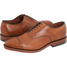 I think the most interesting men wear tan dress shoes.  The stand out from the uniform black shoes you usually see walking down the halls and they look just so damn... Italian.  I love these beautiful, but pricey tan oxfords by Allen Edmonds.  The feature a more modern cap toe design but with the traditional brogueing you'd see on wingtips.  Very classy, yet not boring.