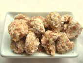 """Coconut-Covered Cashews. """"Crunchy cashews are coated with a sweet layer of toasted coconut. This distinctive tropical treat is nearly irresistible."""""""