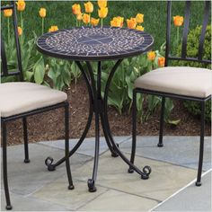 "Patio Furniture for Small Outdoor Spaces: Vulcano Bistro Table from Alfresco Home: The Vulcano bistro table from Alfresco Home has a tabletop that is extremely popular in outdoor settings. Mosaic tabletops not only look attractive, but hold up pretty well in outdoor settings. The Vulcano bisstro table is 24"" round and the mosaic top is inlaid in a powder coated iron tray. The table has adjustable base feet and galvanized hardware is used throughout."