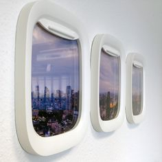 The view from your aeroplane porthole is incredible:Air Frames. Cute in a boys room above the bed