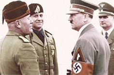 Mussolini and Hitler converse under the approving stares of Italian Foreign minister Ciano and deputy Fuhrer Hess. This is a very rare occasion of Hitler wearing the triangular patch of the Italian Fascist Party over his swastika arm band. The German dictator was averse to decorations and other personal regalia in general displaying only his Iron Cross and the Nazi Party pin.